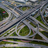 Top view of Highway road junctions. The Intersecting freeway road overpass the eastern outer ring road of Bangkok, Thailand.